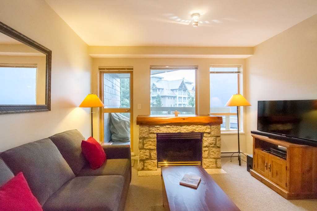 Living Area with gas fireplace, leading onto a small balcony (great for the summer!)