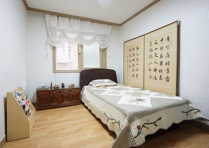 Single bed with calligraphy folding Screen.