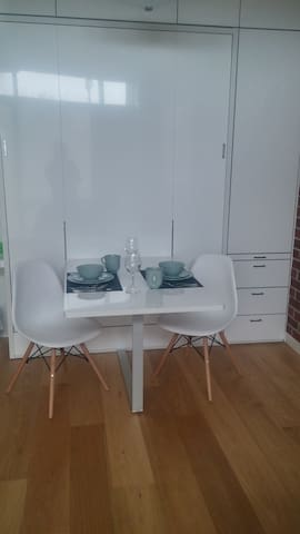 dinning table pops up once bed is put back up into the wall