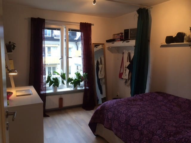 Second bedroom with windows facing inner yard, and nice view of Södermalm roof tops.