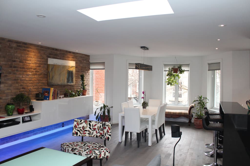 Open space includes dining area many windows and 2 skylights.