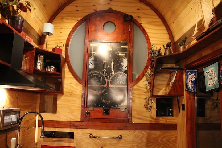 """""""Engine room"""" door to the steampunk wet room."""