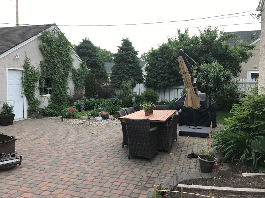 Garage that you will have access to if you wish. There is also a ton of front street parking. Rock garden and BBQ area. You are more then welcome to use this area.