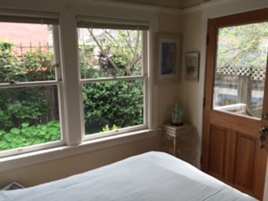 This is the downstairs, master bedroom which receives bright light and has a door to the garden.