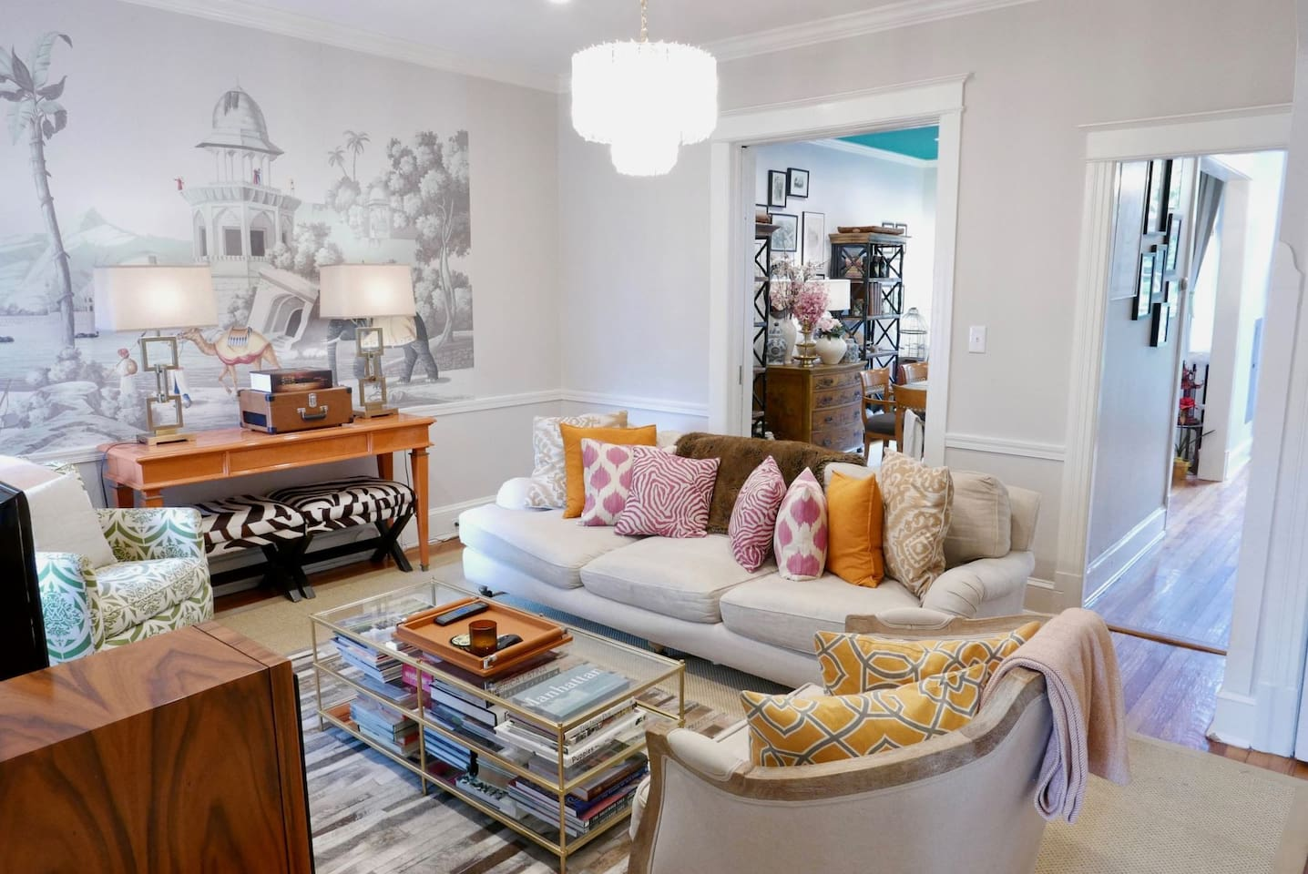 Stunning living room with original artwork creating a Bollywood aesthetic