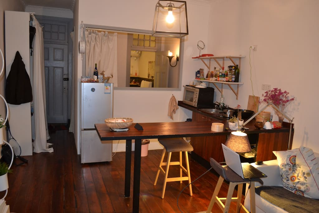 Kitchen with living room, bedroom and bathroom in the back