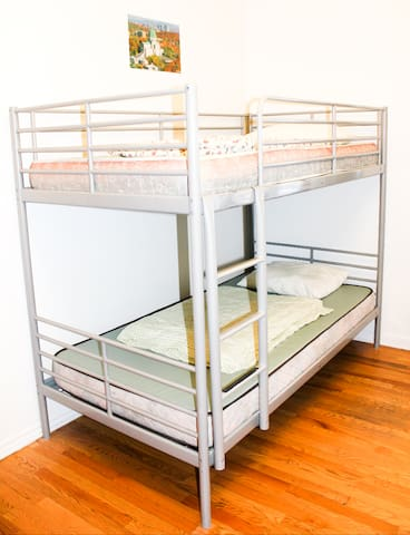 Bunkbeds. P.S. : We provide all the bedsheets and have extra pillows if you wish.