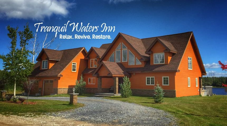 TRANQUIL WATERS INN - WATERFRONT OWLS NEST SUITE