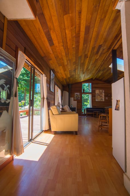 You enter the living space. Big sunny deck on the left side.