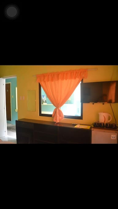 well lighted and ventilated by two big windows. Rooms are provided with electric kettle. Services such as laundry, ironing, hair dryer,charger we provide as requested by our guest.