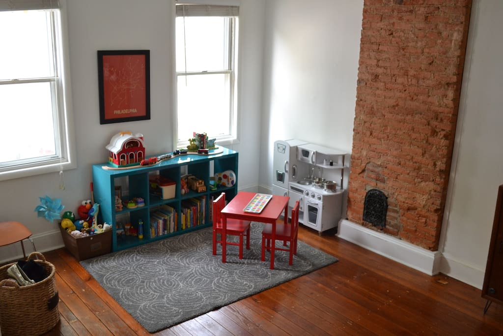 Toddler play space. Can be converted to dining space for long-term rentals sans children.