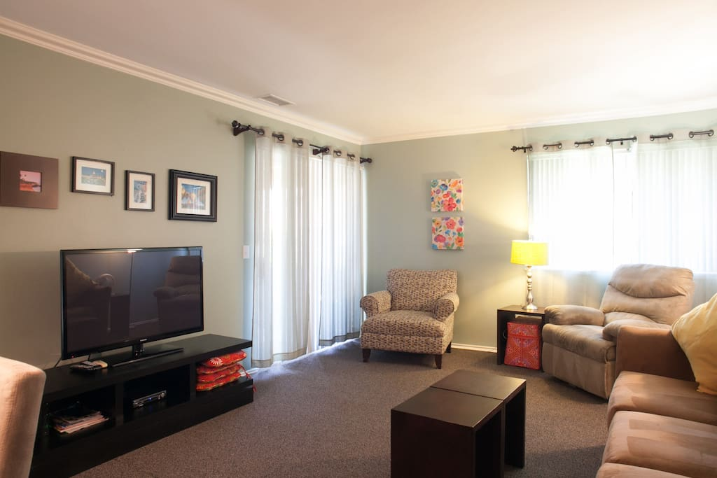 Living room has a large LED TV, premium cable and internet