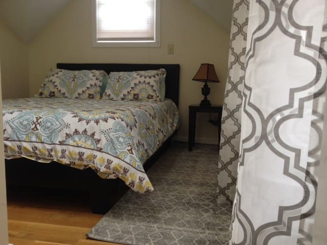 The bedroom is cozy with a comfortable, queen-sized mattress.