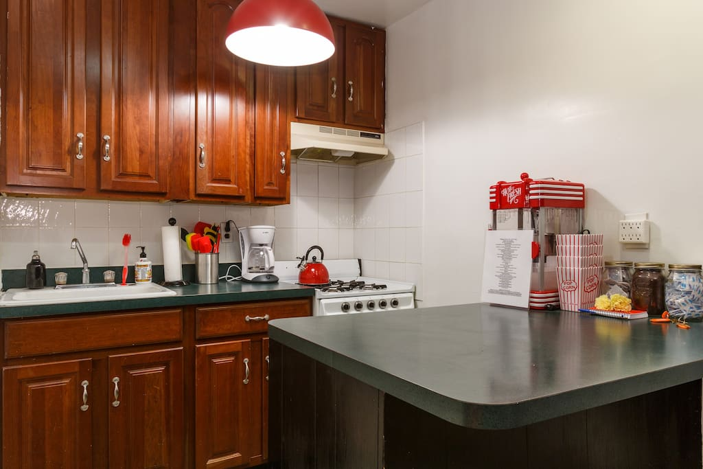 All kitchen utensils as well as a working popcorn machine!