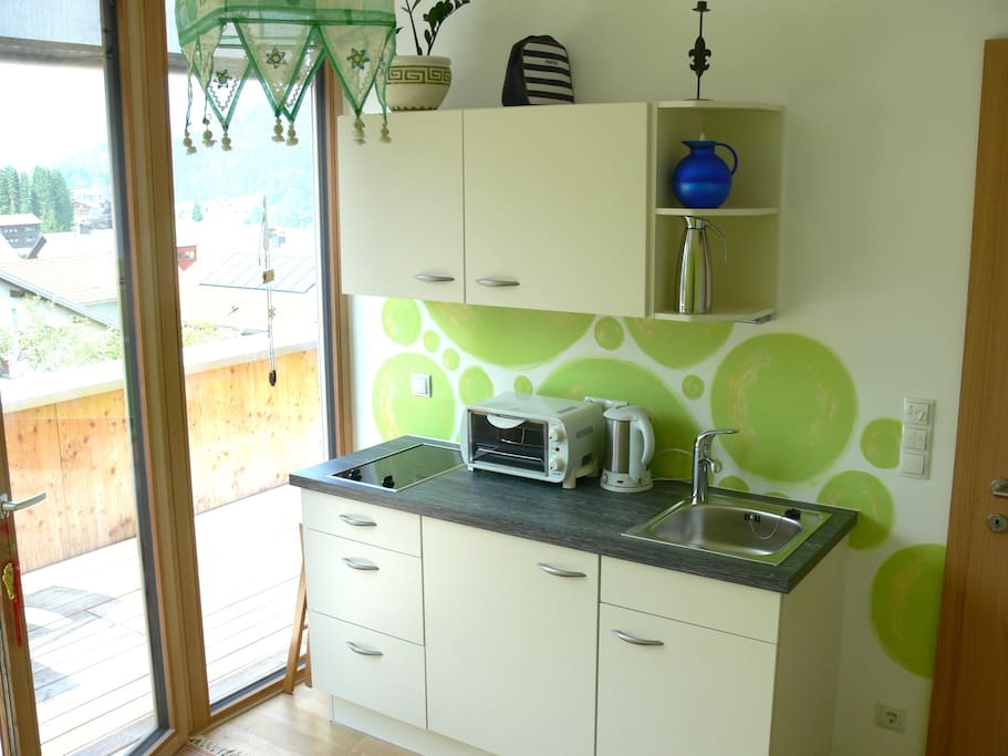 Guest kitchen with basic equipment such as a small fridge, a stove for two pans and a mini oven for pizzas etc..
