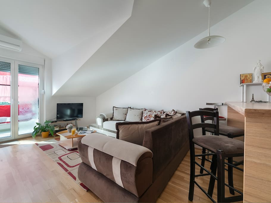 this is a comfortable living room, illuminated and pleasant, overlooking the city and the balcony, guests spend the most time here, very comfortable and provided for a real holiday.