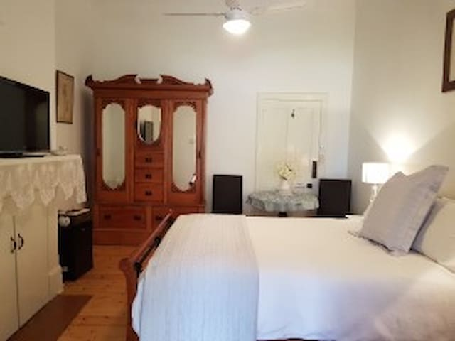 Bedroom with Antique furniture queen size bed & Television