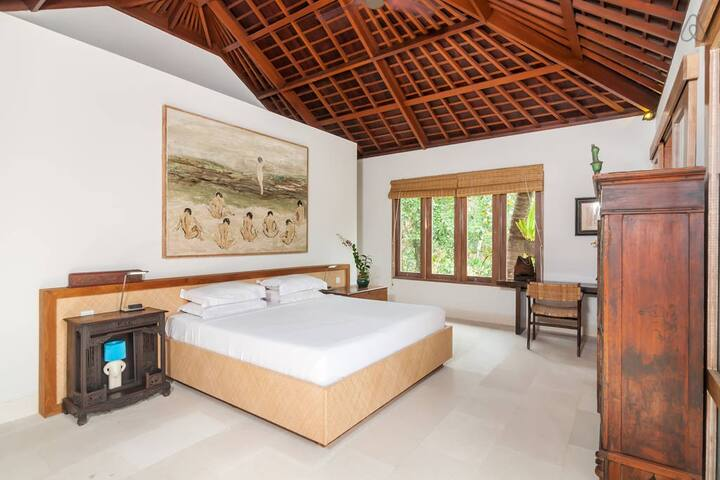 Beautiful big bedroom with Bali style ceiling.