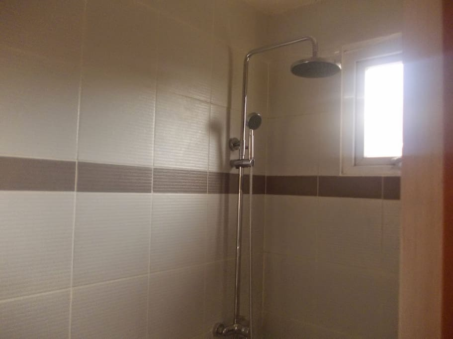 New shower heads in the t&b. The building is new.