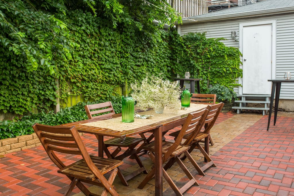 Backyard dining area perfect for moonlit summer dinners and outdoor home cooked brunches