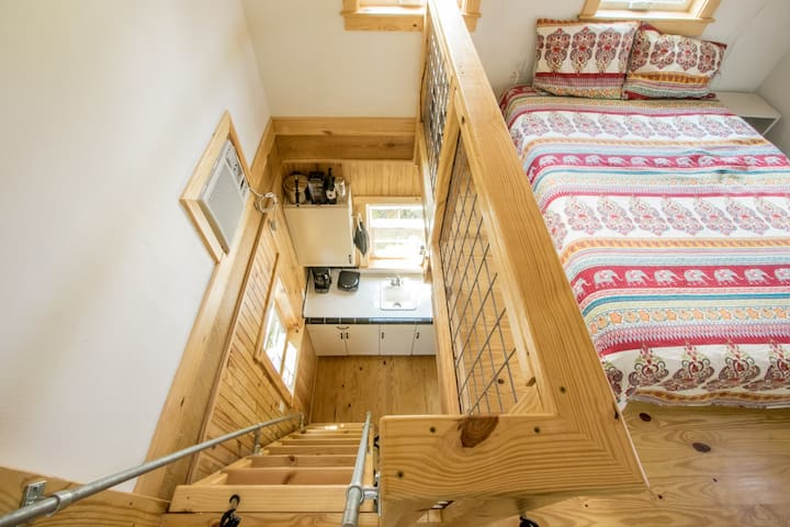 The sleeping loft is accessed by a ships ladder. While solid with good treads and hand rails, it's much steeper than a staircase.  Take note! This climb may not be for everyone.