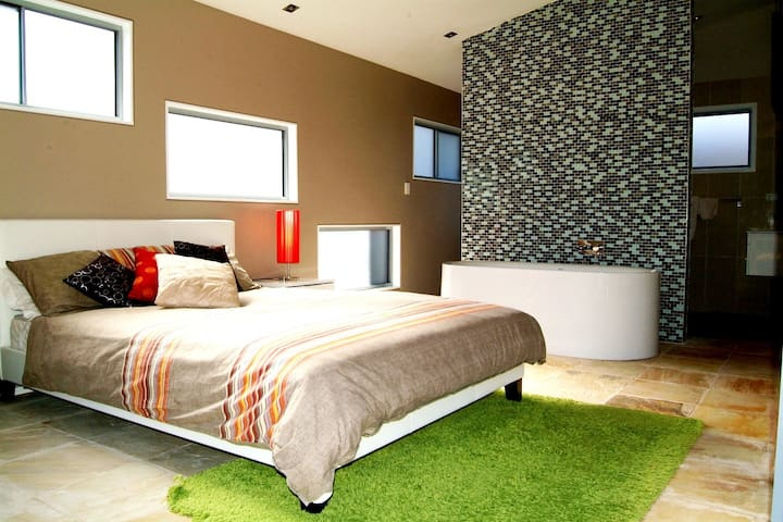 Honeymoon suite with opaque windows and blinds for privacy.