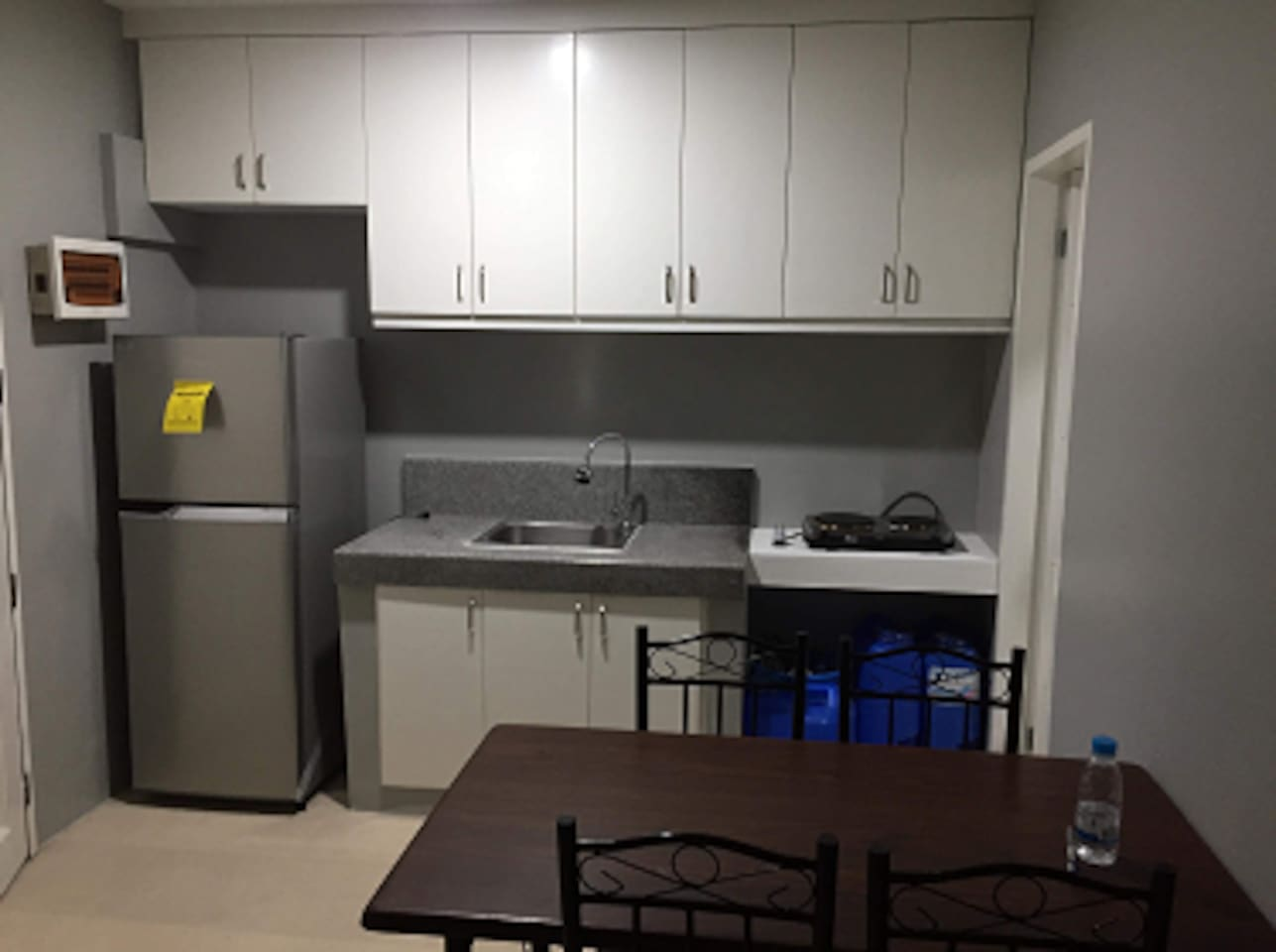 1st floor - Kitchen and Dining with built in cabinets - includes refrigerator, electronic stove