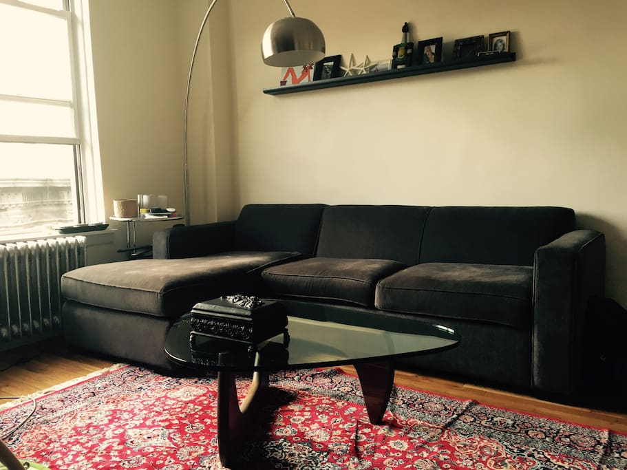 Living room with Noguchi table, Arco Floor Lamp and hand made Iranian silk rug