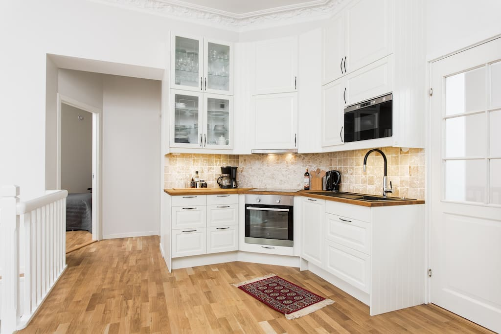 Kitchen with entrance to the 2 large bedrooms in the flat.