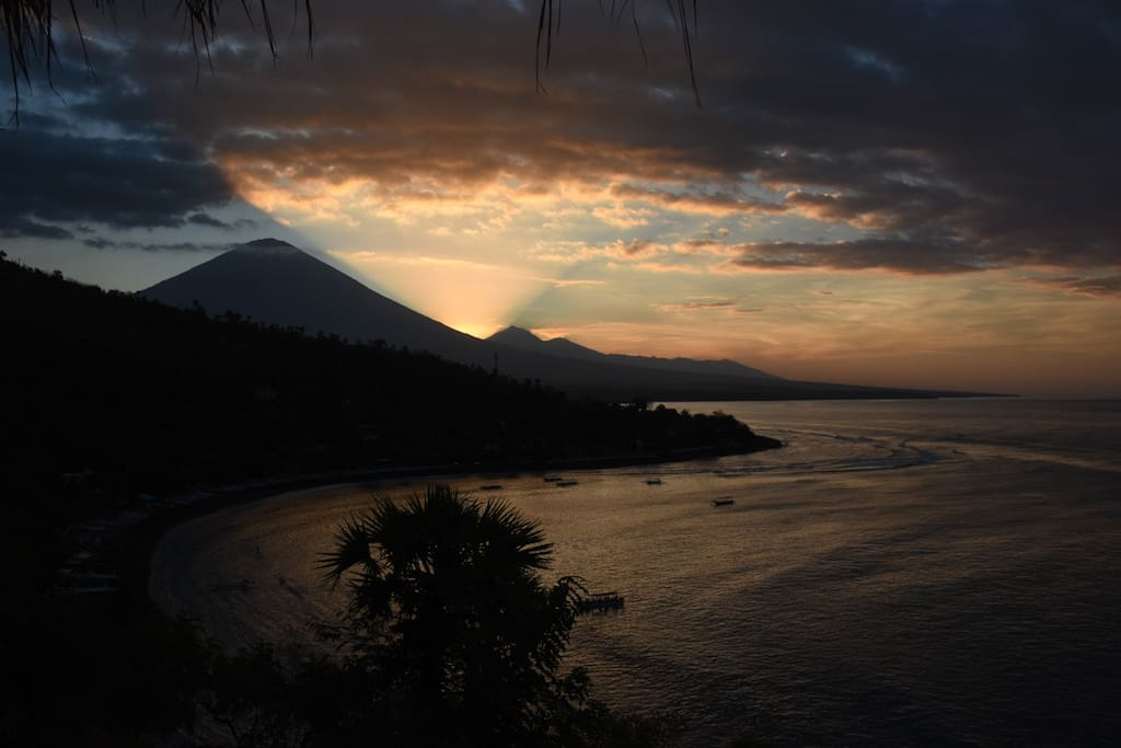 Three minutes down the road is Sunset Point, with a nightly light show in the sky over Mt. Agung.