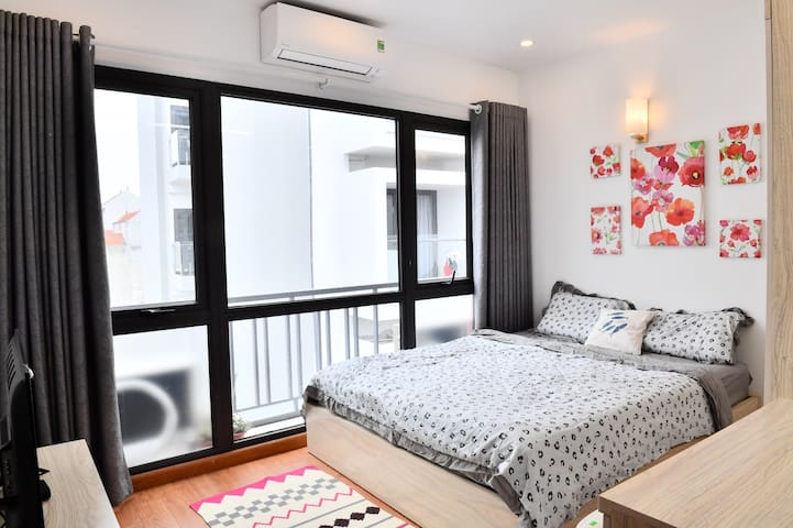 Bedroom with large city view, king size bed and spacious wardrobe, working desk, smart TV has sallite channels.