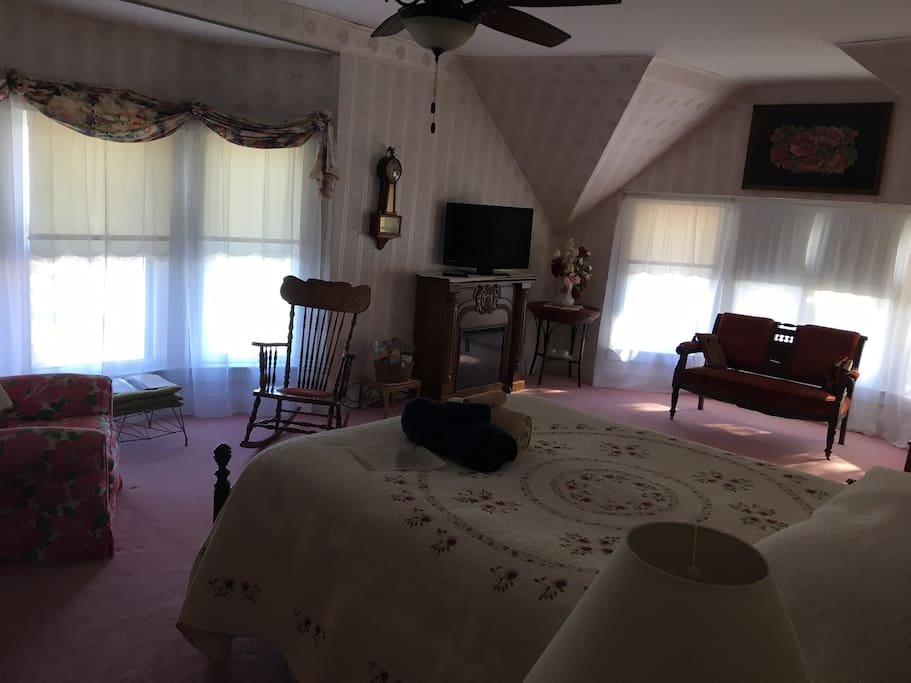 Master Bedroom  300 square feet, 7 windows that overlook the Warroad River, fireplace, tv, queen bed, ceiling fan, wifi, and is located on the 2nd floor.