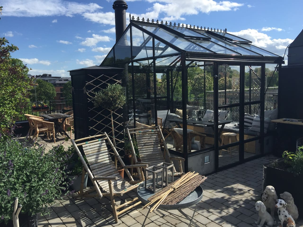 Our own private roof terrace with a small glass house, and a fire place so that you can have dinner on the roof top even on colder days. Large enough for 6-8 people having dinner.