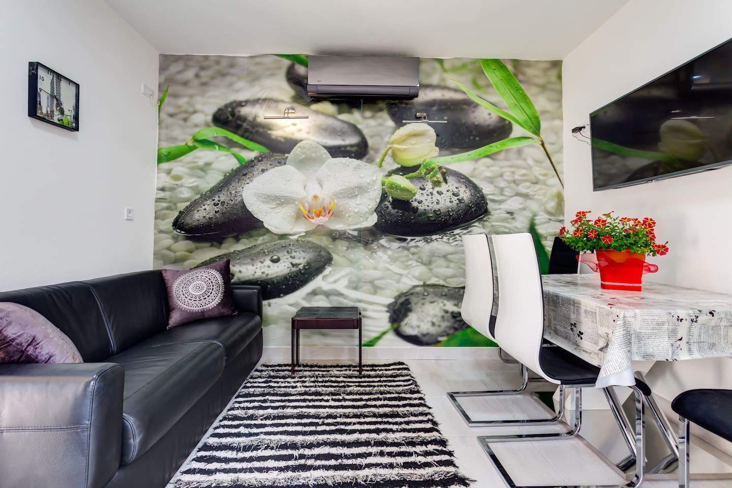 One bedroom apartment in modern style is nice and relaxing place to spend your holiday. Just a few minutes away from the beach, this refreshing space is an ideal summer oasis.