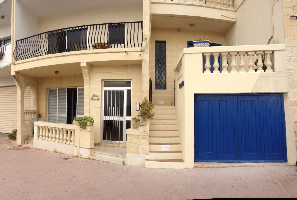 the house BY THE SEA (the one with the blue doors)