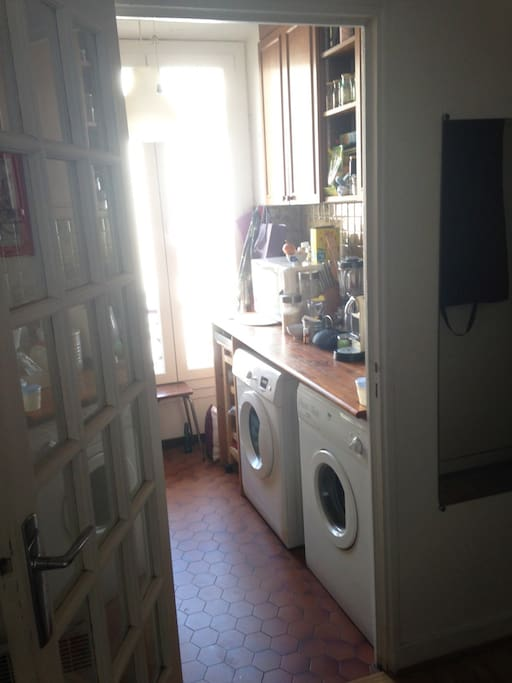 kitchen with a washing machine and a tumble dryer