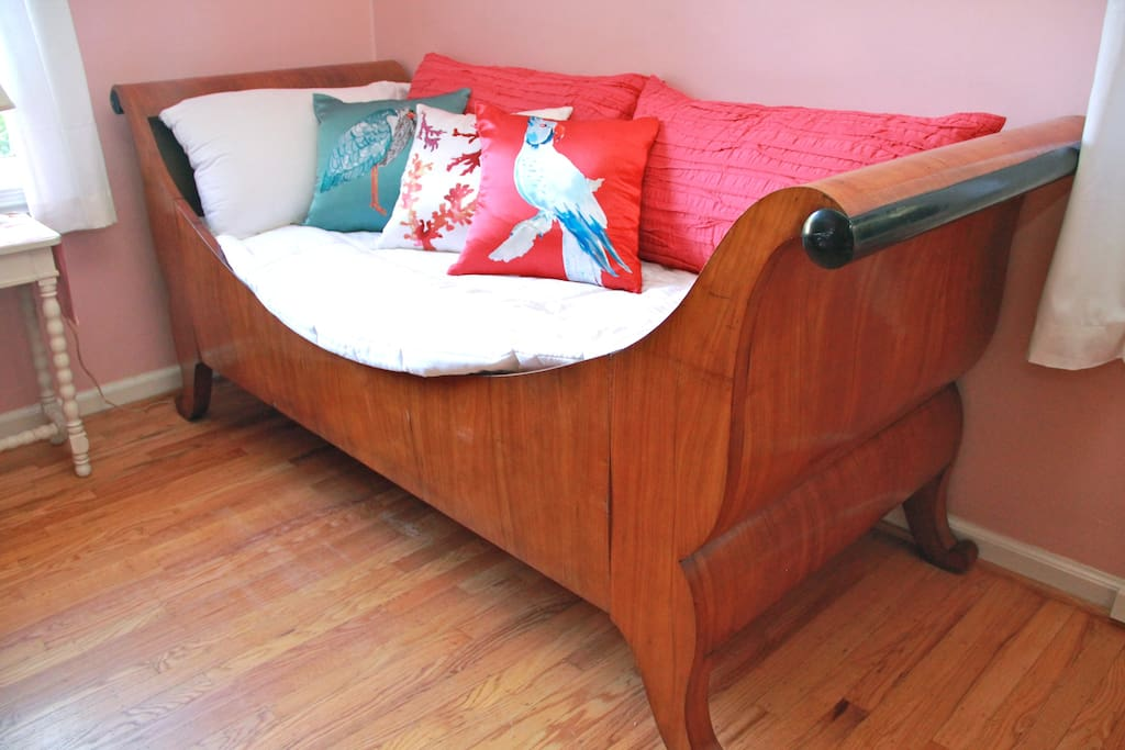 The daybed affords comfort for reading and sleeping.