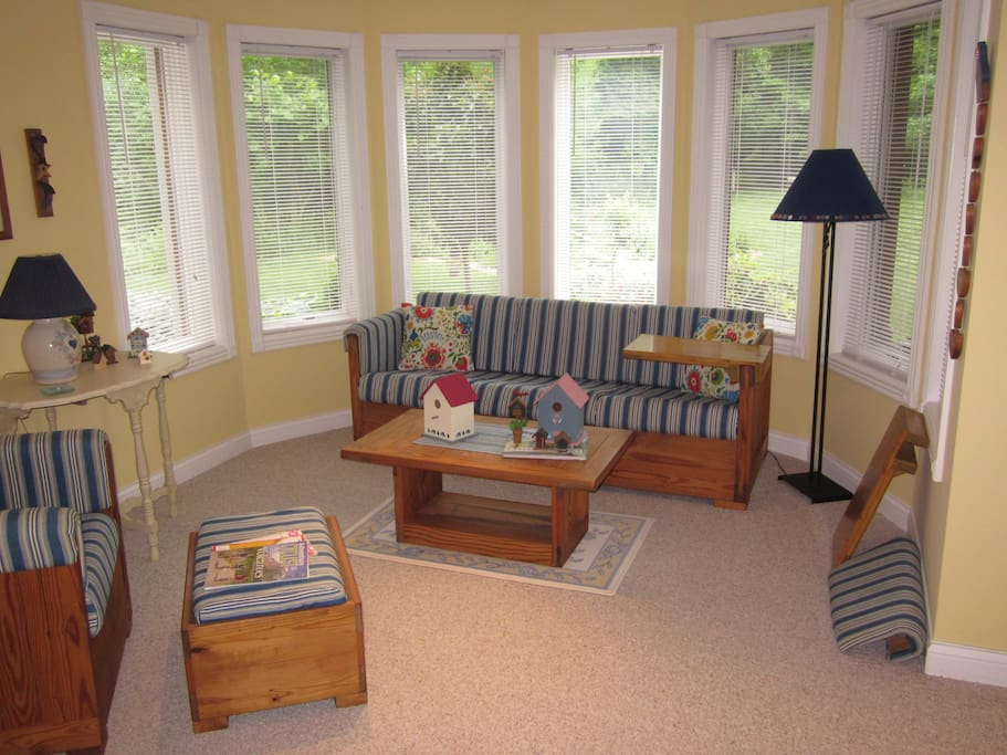 Spacious seating area in bedroom, with view of back yard.