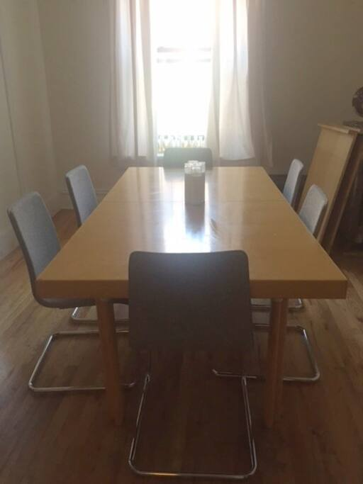 Large Dining Room perfect for morning coffee or hosting Dinner Parties. Great Natural Lighting.