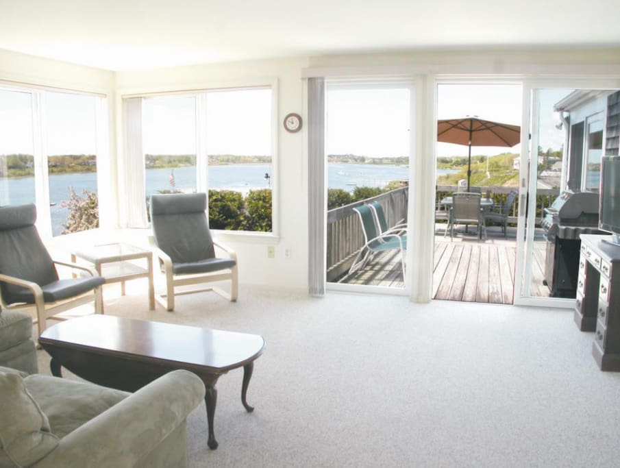 Bright Sun Room has expansive water views, HD TV, access to deck, central AC.