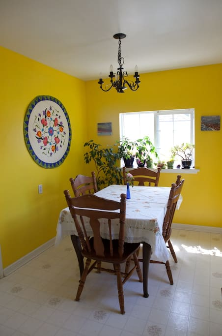 Sunny dining room with 4 seats.  Additional chairs and highchair available.