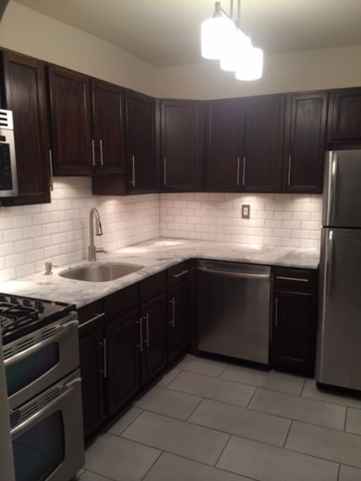 Brand new Kitchen with Granite Counter Tops and Stainless Steel Appliances