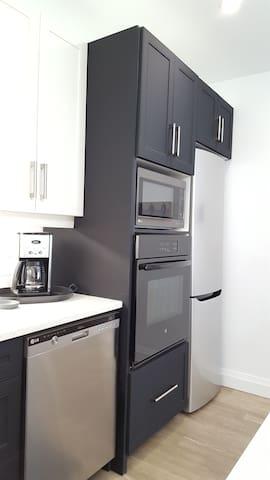 Loft fridge, wall oven, large microwave and dishwasher.
