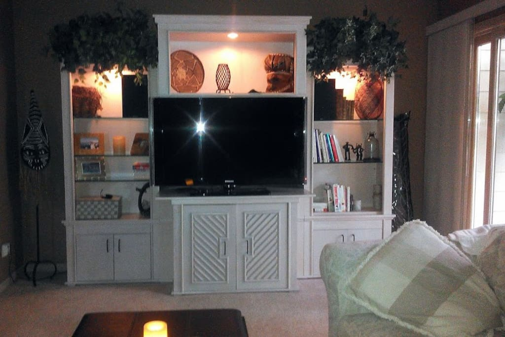 48 in. TV with Roku (for streaming content) in sitting area off of the bedroom. 3 Season porch w/ gas grill to the right.