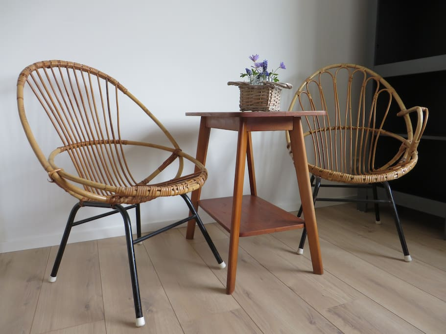 There is a table with two chairs in the room