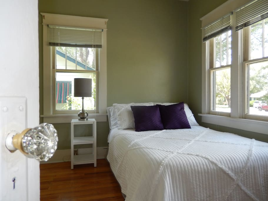 Turn the original glass door knob and enter a clean, bright bedroom.
