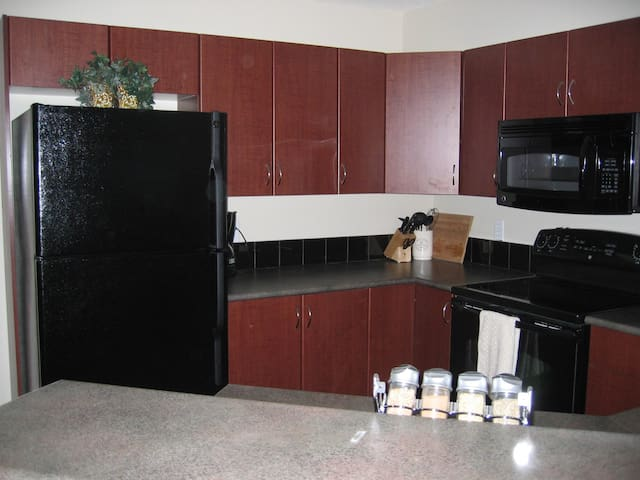 Kitchen with full size modern appliances.  Kitchen has a Tassimo Coffee Maker and a regular coffee maker.