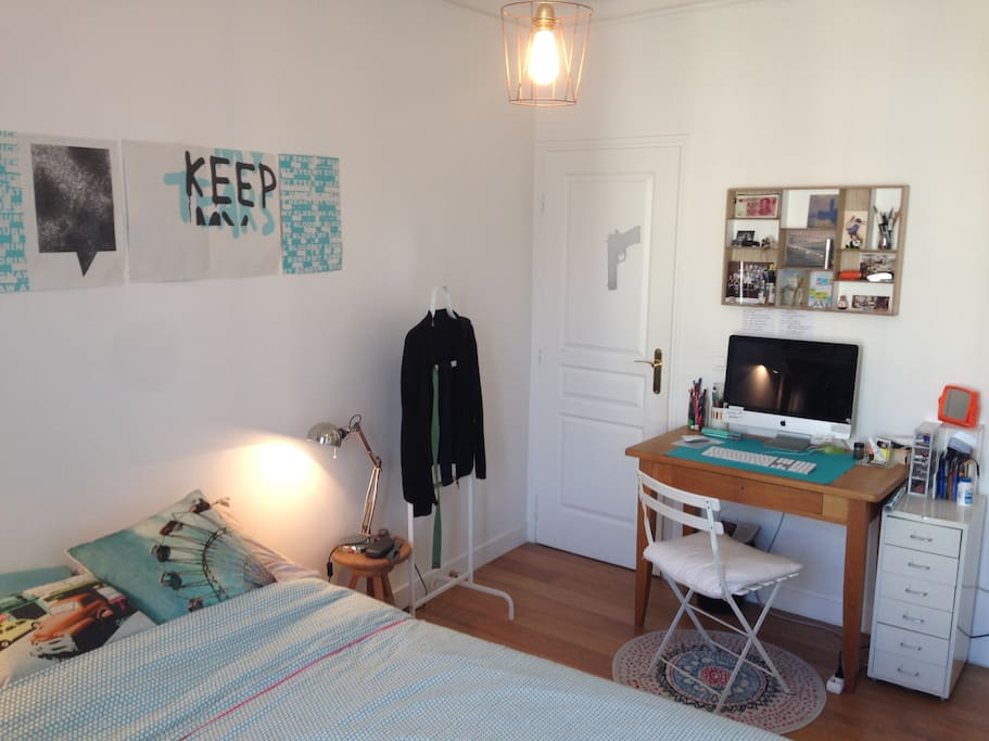 Bedroom with desk and a chair