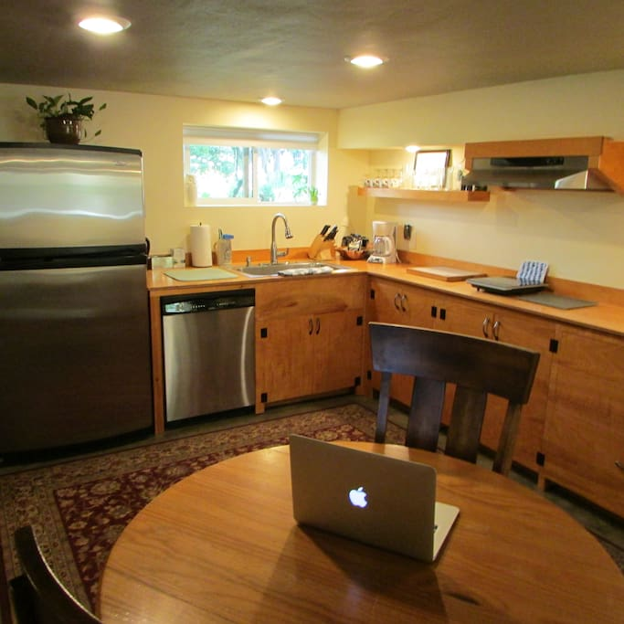 Spacious feeling kitchen, makes a great work space as well!  Full size fridge with ice maker, oversized sink w/ disposal.  Dishwasher of course.