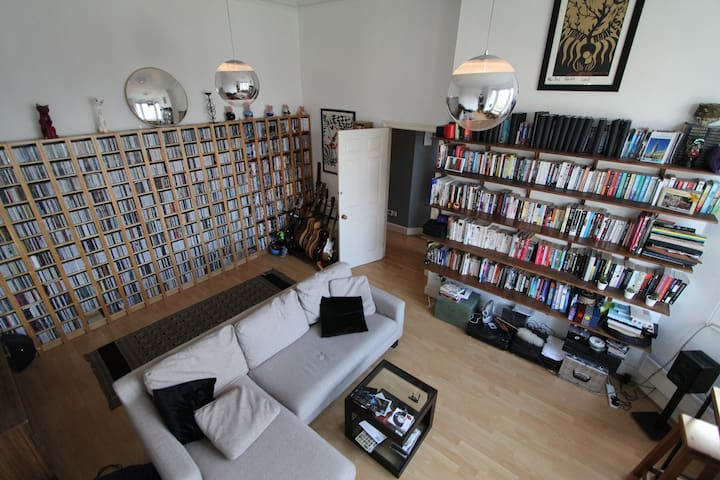 Our lovely front room. High ceilings & a few cds !
